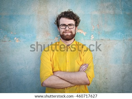 Portrait of man with yellow shirt #460717627