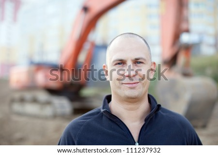 Portrait of manual worker at building site