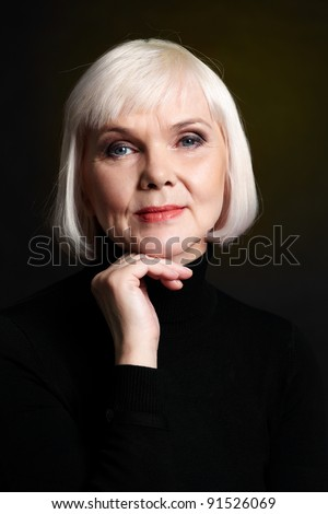 Portrait of mature blond female looking at camera