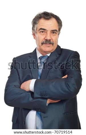 Portrait of mature business man standing with arms folded isolated on white background