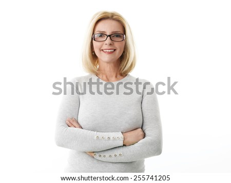 Portrait of mature business woman smile while standing against white background.  - Shutterstock ID 255741205