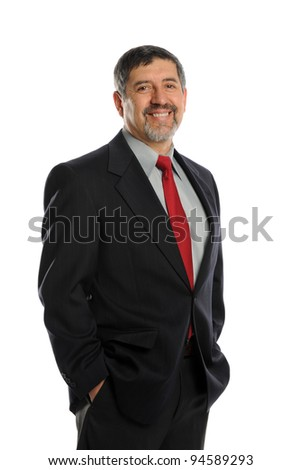 Portrait of mature businessman smiling with his hands in pockets