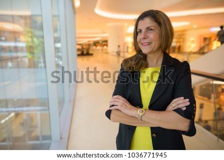 Portrait of mature businesswoman exploring the city of Bangkok, Thailand