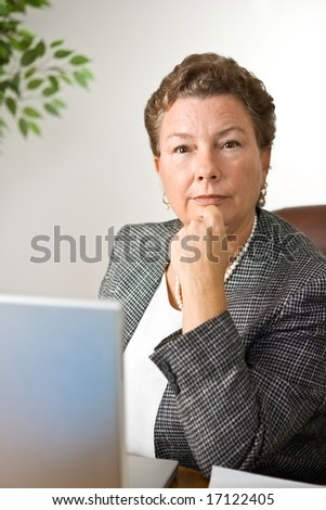 Portrait of mature businesswoman looking with determination straight into the camera