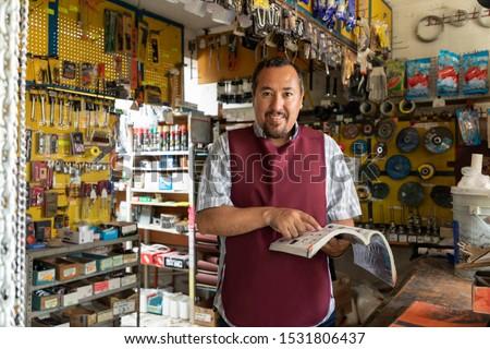 Portrait of mature latin entrepreneur man with retail business background. Foto stock ©