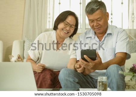 Portrait of mature man and his wife retirement Planning financial at home. Retirement Plan Retirement Planning Pension Concept