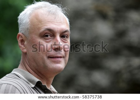 Portrait of mature man in the park at summer