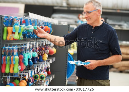 stock photo portrait of mature man selecting dog toys from the pet store 83017726 Lita Ford