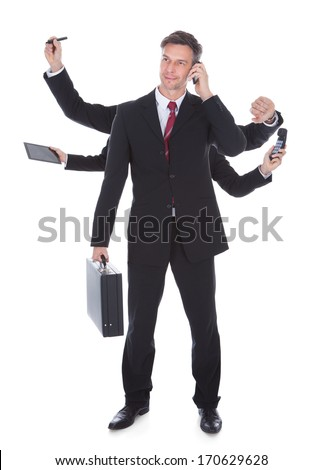 Portrait Of Mature Multitasking Businessman Isolated Over White Background