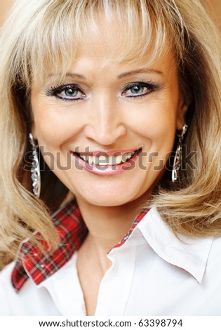 Portrait of mature smiling business woman close up