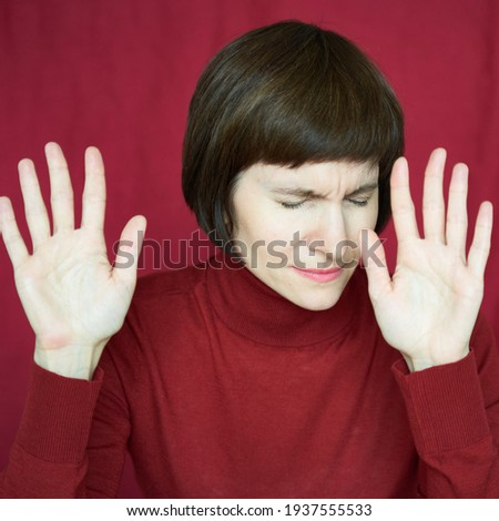 Portrait of mature woman in distress, hands up, stoping situation, stop gest. Agitated tensed face. Middle-aged beautiful female. Excess information. Difficult situation, problems. Anxiety, stress Zdjęcia stock ©