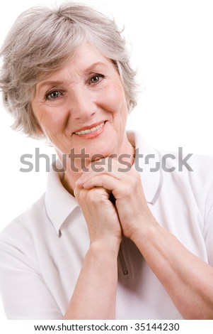 Portrait of mature woman smiling at camera over white background