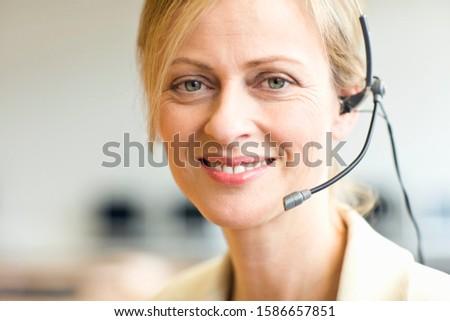 Portrait of mature woman wearing headset