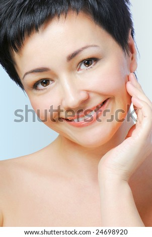 Portrait of mature woman with health skin of face