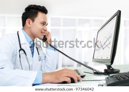 portrait of medical doctor working with his computer