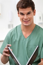 Portrait of medical practitioner holding a book and smiling