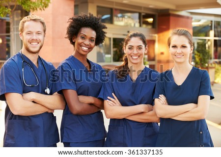 Portrait Of Medical Team Standing Outside Hospital