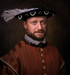 Portrait of medieval man in vintage clothing on dark background.