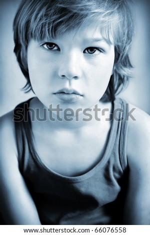 Portrait of melancholic boy, toned in selenium tone