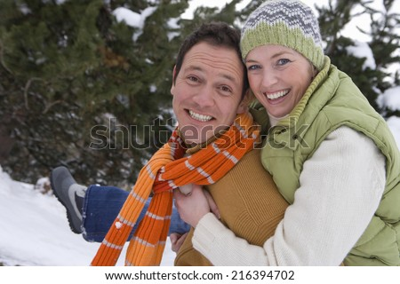 Portrait of mid adult couple in winter setting