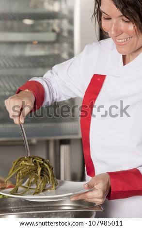 portrait of mid adult female chef in kitchen