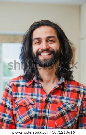 Portrait of mid adult man indoors.