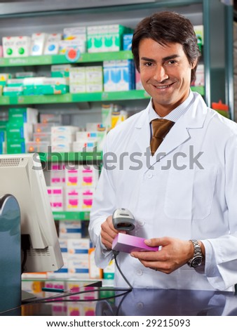 portrait of mid adult pharmacist scanning medicine with barcode reader