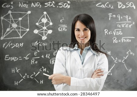 portrait of mid adult teacher looking at camera