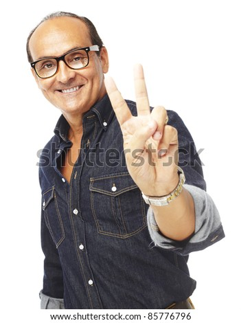 portrait of middle aged man doing good symbol against a white background