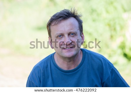 Portrait of middle-aged man relaxing on the nature in summer day, close up Photo stock ©
