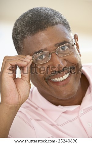 Portrait Of Middle Aged Man Trying On Glasses