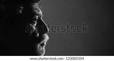 Portrait of middle aged men with hard lighting, studio - stock photo