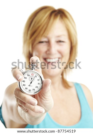 portrait of middle aged woman holding stopwatch over white - stock photo