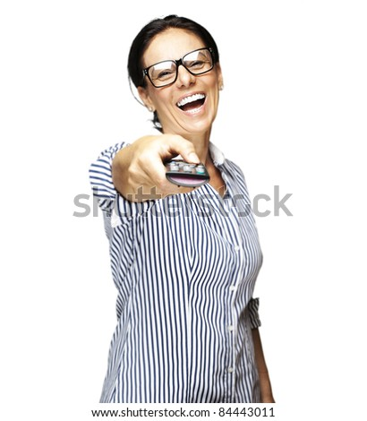 portrait of middle aged woman laughing using a remote control tv on white