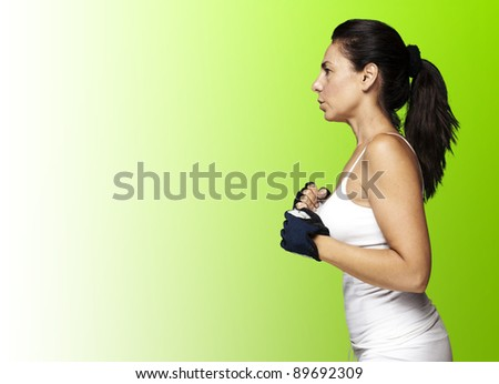 portrait of middle aged woman running against a green background