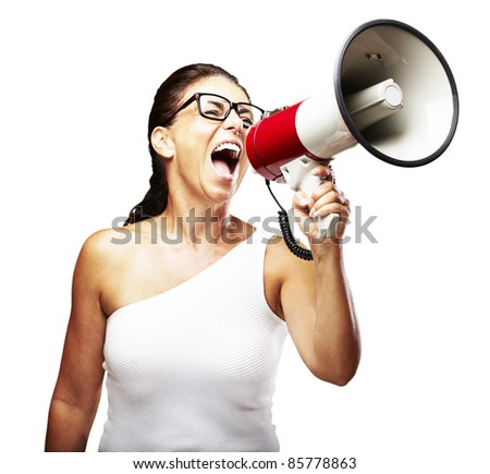 portrait of middle aged woman shouting using megaphone over white background