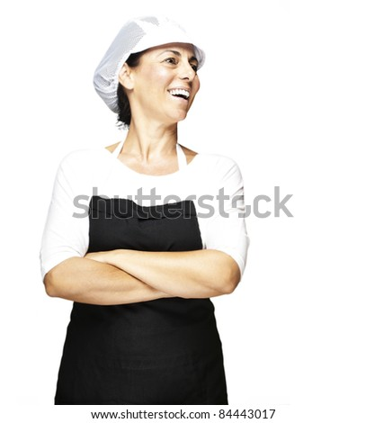 portrait of middle aged woman wearing apron and mesh top hat against a white background