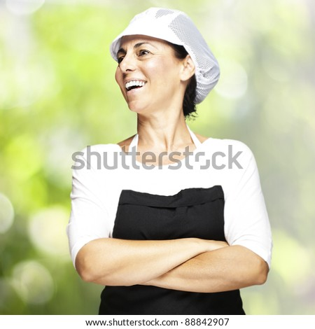 portrait of middle aged woman with apron and mesh top hat at outdoor