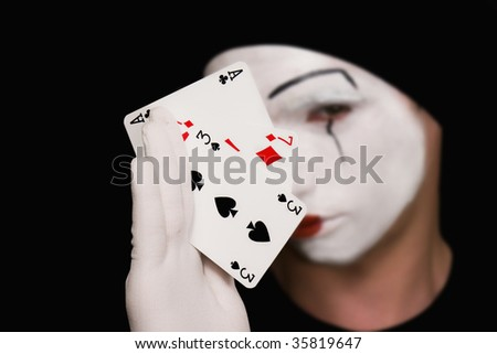 Portrait of  mime with playing cards on  black background - stock photo
