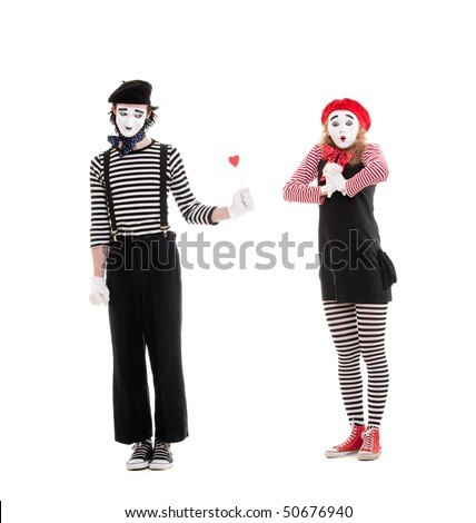 portrait of mimes. man giving small red heart to amazed woman. isolated on white background