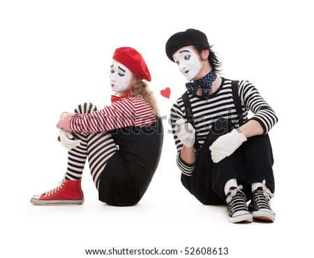 portrait of mimes. smiley man giving heart to sad woman. isolated on white background - stock photo