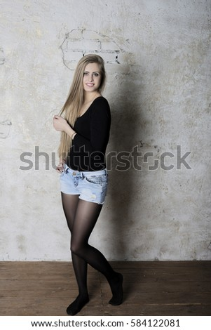 portrait of model in studio with bad wall #584122081