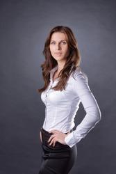 portrait of modern business woman on dark background.