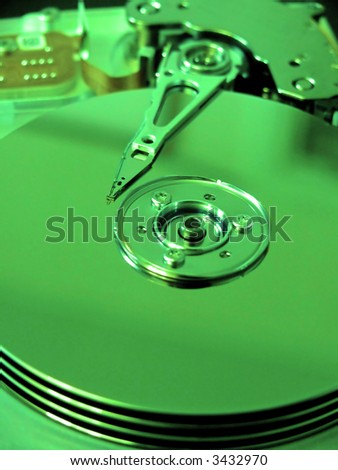 portrait of modern computer harddrive with focus on needle (Green Filter)