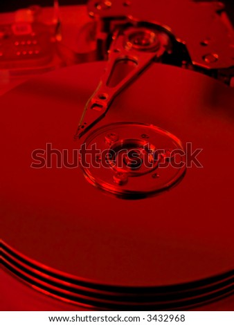 portrait of modern computer harddrive with focus on needle (Red Filter)