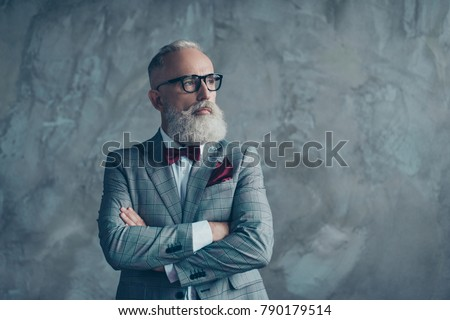 Portrait of modern luxurious trendy wealthy intelligent dreamy pensive stylish authoritative clever man wearing checkered grey jacket chic maroon bow-tie imagine smth, isolated on concrete background #790179514