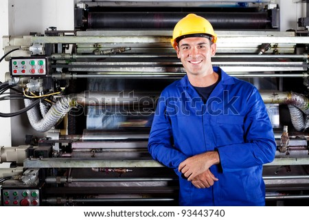 portrait of modern printing press operator in factory