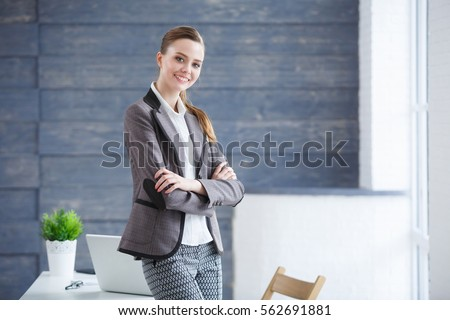 Portrait of modern young business woman in the modern office #562691881
