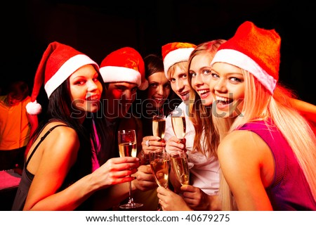 Portrait of modern young people enjoying themselves at Christmas party