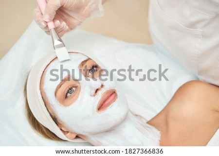 Portrait of moisturizing mask on white background for medical design. Woman skin procedure. Natural cosmetic products. Beauty face. Facial cosmetology treatment. Healthcare peeling cream Photo stock ©